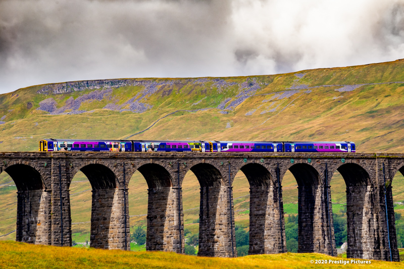 Northern train running across the Ribblehead viaduct