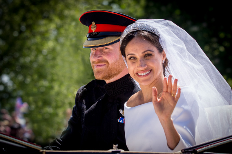 Harry & Meghan in their open carriage